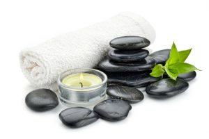 zen basalt stones and massage oil on the white..Others spa teme in this lightbox http://www.istockphoto.com/file_search.php?action=file&lightboxID=7989999
