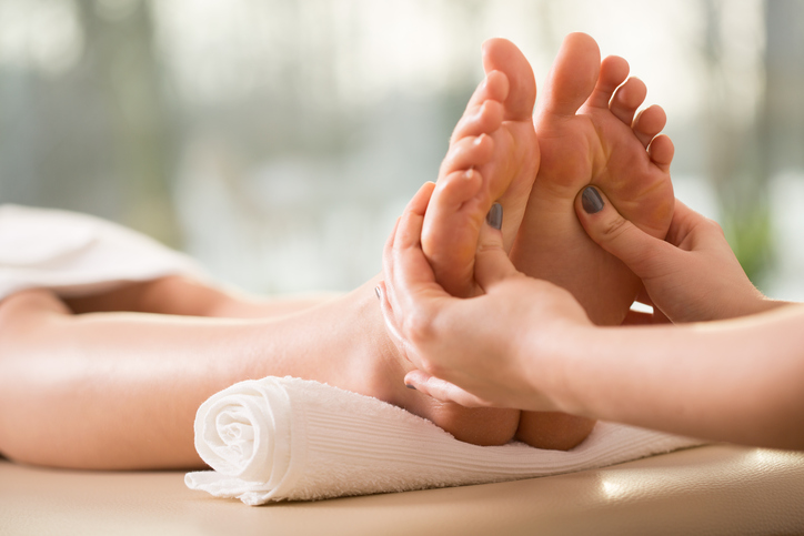 Close-up of young woman having reflexology
