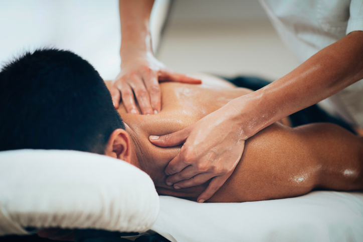 Sports massage. Physical therapist massaging shoulder region