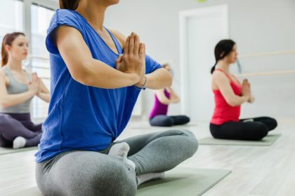 Group Of Women Doing Yoga Indoors